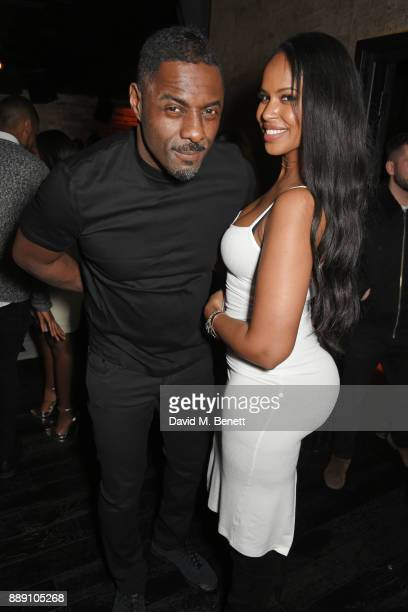 Idris Elba and Sabrina Dhowre attend Idris Elba's Christmas Party at Kadie's Cocktail Bar Club on December 9 2017 in London England