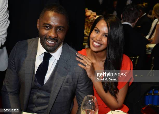 Idris Elba and Sabrina Dhowre attend The 64th Evening Standard Theatre Awards at the Theatre Royal Drury Lane on November 18 2018 in London England