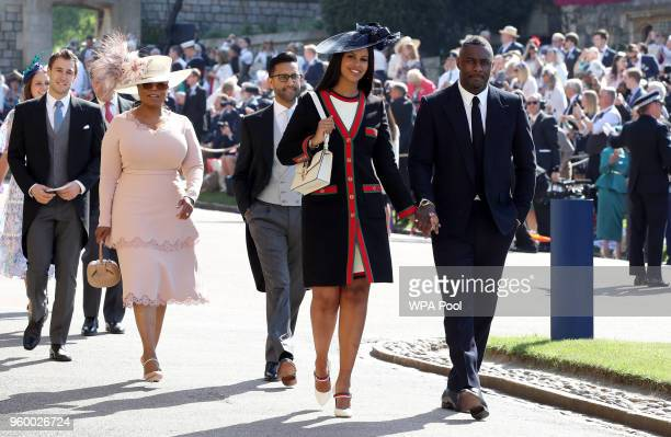 Idris Elba and Sabrina Dhowre followed by Oprah Winfrey arrive at St George's Chapel at Windsor Castle for the wedding of Meghan Markle and Prince...