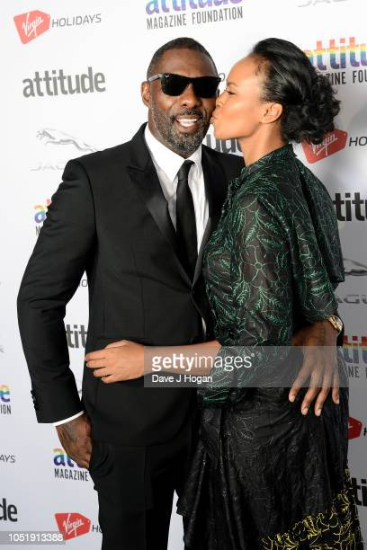 Idris Elba and Sabrina Dhowre pose in the winner's room at The Virgin Holidays Attitude Awards at The Roundhouse on October 11 2018 in London England