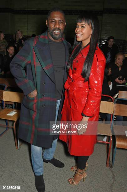 Idris Elba and Sabrina Dhowre wearing Burberry at the Burberry February 2018 show during London Fashion Week at Dimco Buildings on February 17 2018...