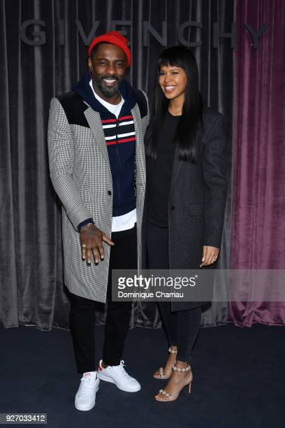 Idris Elba and Sabrina Dowhre attend the Givenchy show as part of the Paris Fashion Week Womenswear Fall/Winter 2018/2019 on March 4 2018 in Paris...