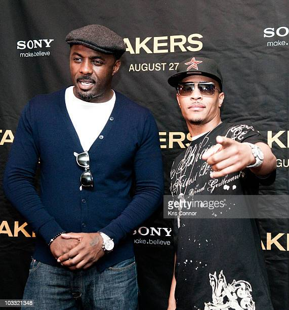 Idris Elba and TI pose for photographers during a screening of Takers at the AMC Georgetown on August 9 2010 in Washington DC