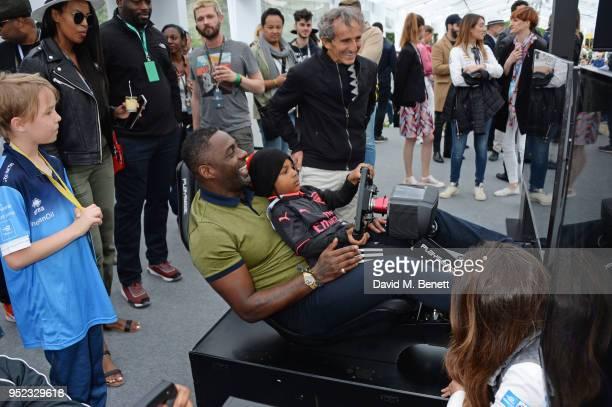 Idris Elba drives a simulator with son Winston Elba and Alain Prost attend the ABB FIA Formula E Qatar Airways Paris EPrix 2018 on April 28 2018 in...