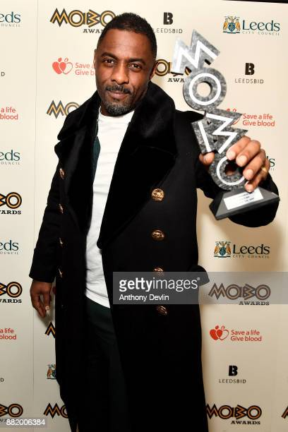 Idris Elba poses in the winners room with the Paving The Way award at the MOBO Awards at First Direct Arena Leeds on November 29 2017 in Leeds England