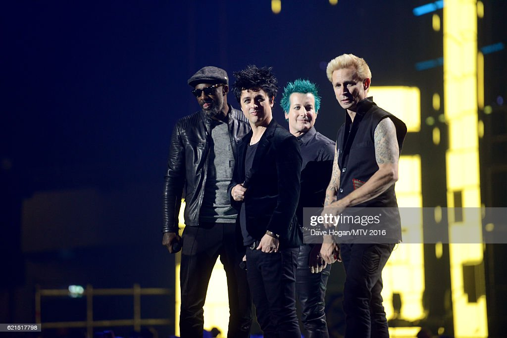 Idris Elba presents Global Icon award to Tre Cool, Billie Joe Armstrong and Mike Dirnt of Green Day on stage at the MTV Europe Music Awards 2016 on November 6, 2016 in Rotterdam, Netherlands.