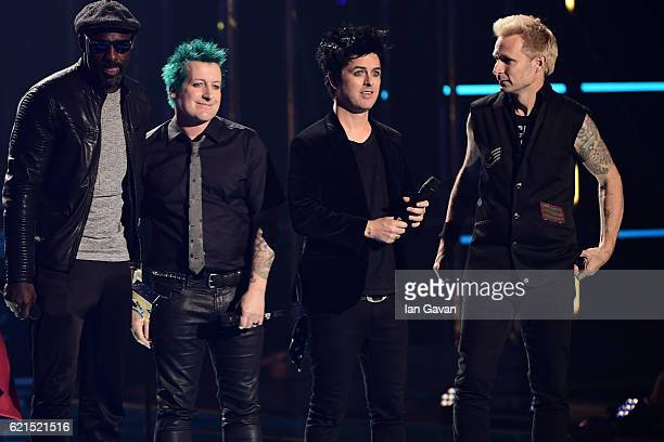 Idris Elba presents the Global Icon award to Tre Cool Billie Joe Armstrong and Mike Dirnt of Green Day on stage at the MTV Europe Music Awards 2016...