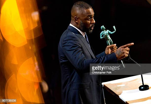 Idris Elba receives the award for Outstanding Performance by a Male Actor in a Supporting Role for 'Beasts of No Nation' onstage during The 22nd...