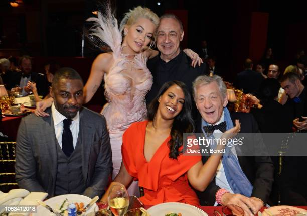 Idris Elba Rita Ora Sir Len Blavatnik Sabrina Dhowre and Sir Ian McKellen attend The 64th Evening Standard Theatre Awards at the Theatre Royal Drury...