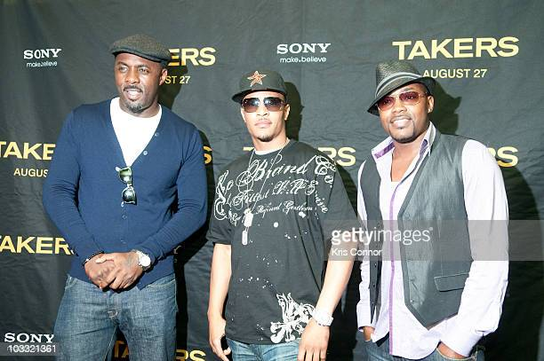 Idris Elba TI and Will Packer pose for photographers during a screening of Takers at the AMC Georgetown on August 9 2010 in Washington DC