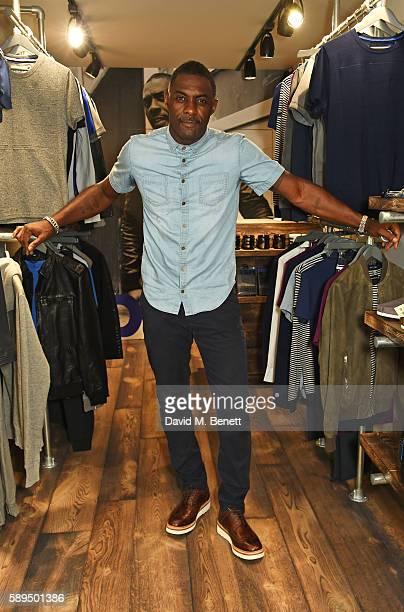 Idris Elba wearing the Idris Elba Superdry IE Ghost Button Down Denim Shirt celebrates the launch of his new Boxpark retail space which will stock...