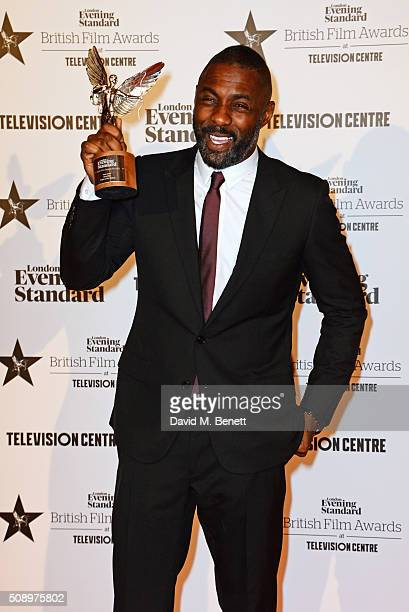 Idris Elba winner of the Best Actor award for 'Beasts Of No Nation' poses in front of the Winners Boards at the London Evening Standard British Film...
