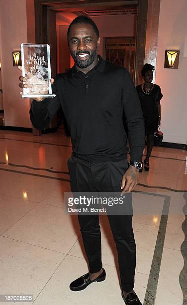 Idris Elba, winner of the Man of the Year award, attends the Harper's Bazaar Women of the Year awards at Claridge's Hotel on November 5, 2013 in...