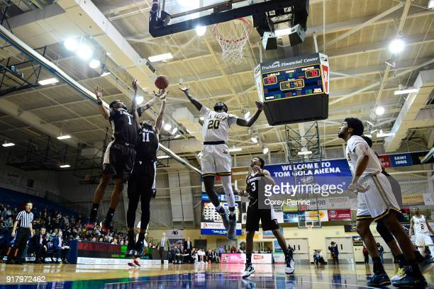 Idris Taqqee Courtney Stockard of the St Bonaventure Bonnies and BJ Johnson of the La Salle Explorers vie for a rebound off the glass during the...