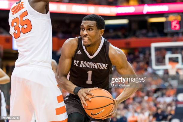 Idris Taqqee of the St Bonaventure Bonnies drives to the basket as Bourama Sidibe of the Syracuse Orange defends during the first half at the Carrier...