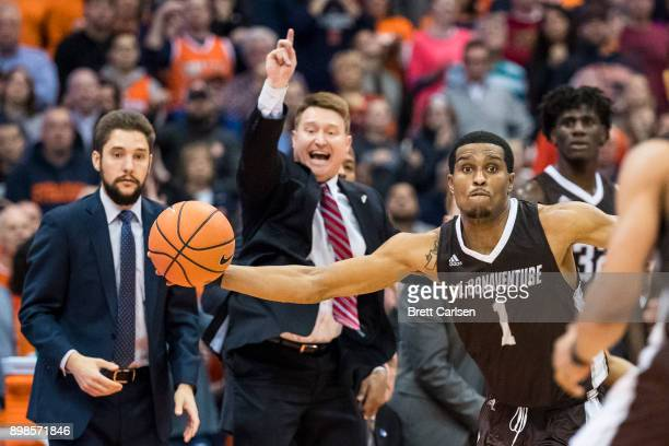 Idris Taqqee of the St Bonaventure Bonnies saves a ball from going out of bounds by passing it to Jaylen Adams during the second half against the...