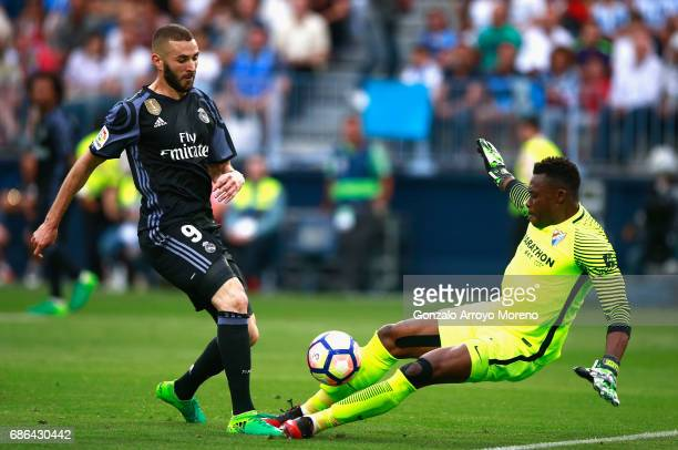 Idriss Carlos of Malaga makes a save from Karim Benzema of Real Madrid during the La Liga match between Malaga and Real Madrid at La Rosaleda Stadium...