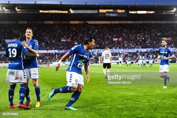 Idriss Saadi of RC Strasbourg celebrates his goal with teammates during the Ligue 1 match between Strasbourg and OGC Nice at on April 28 2018 in...
