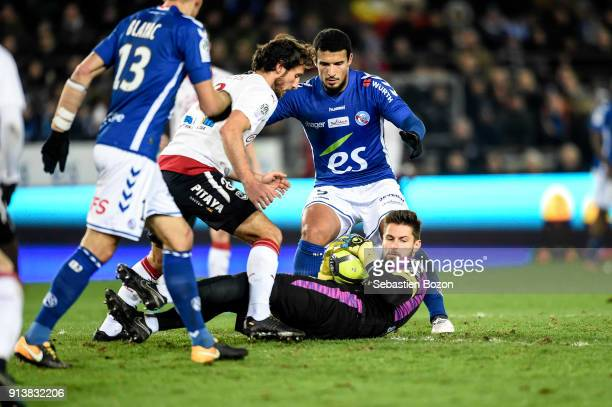 Idriss Saadi of Strasbourg and Benoit Costil of Bordeaux during the Ligue 1 match between Strasbourg and Bordeaux at on February 3 2018 in Strasbourg
