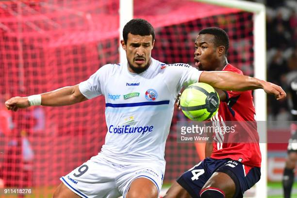 Idriss Saadi of Strasbourg and Kouadio Yves Dabila of Lille during the Ligue 1 match between Lille OSC and Strasbourg at Stade Pierre Mauroy on...