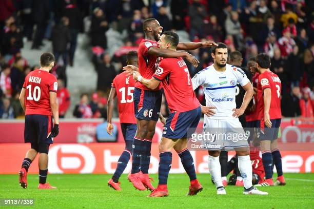 Idriss Saadi of Strasbourg looks on as captain Ibrahim Amadou of Lille and Anwar El Ghazi of Lille celebrate their last minute win in the Ligue 1...