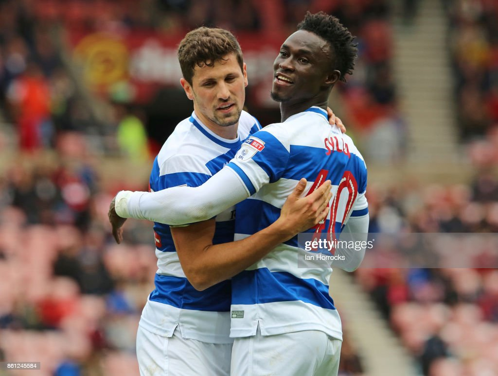 Idriss Sylla of QPR (R) celebrates scoring the opening goal with Pawel Wszolek during the Sky Bet Championship match between Sunderland and Queens Park Rangers at Stadium of Light on October 14, 2017 in Sunderland, England.