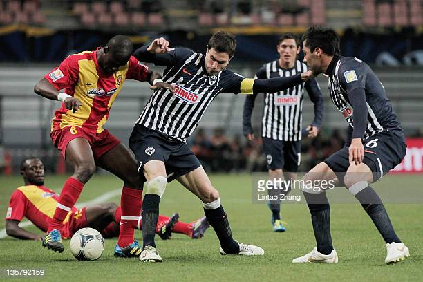 Idrissa Coulibaly of Esperance Sportive de Tunis is challenged by with Jose Maria Basanta of Monterrey during the FIFA Club World Cup 5th Place match...