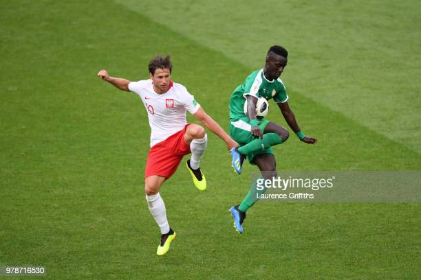 Idrissa Gana Gueye of Senegal and Grzegorz Krychowiak of Poland in action during the 2018 FIFA World Cup Russia group H match between Poland and...