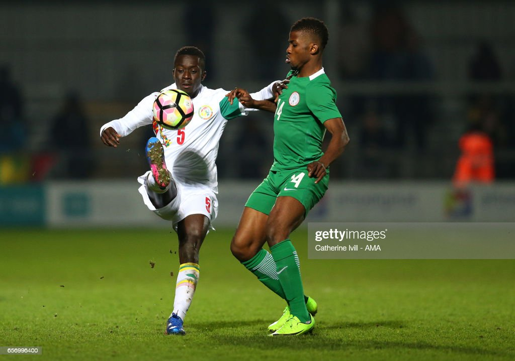 Idrissa Gana Gueye of Senegal and Kelechi Iheanacho of Nigeria during the International Friendly match between Nigeria and Senegal at The Hive on March 23, 2017 in Barnet, England.