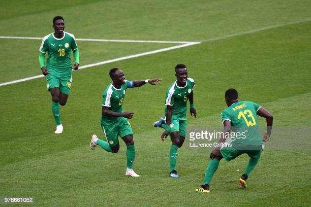 Idrissa Gana Gueye of Senegal celebrates the first Senegal goal with Mbaye Niang Ismaila Sarr and Alfred Ndiaye of Senegal during the 2018 FIFA World...