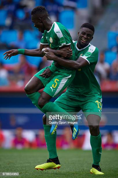 Idrissa Gana Gueye of Senegal celebrates with Alfred Ndiaye of Senegal after scoring his team first goal during the 2018 FIFA World Cup Russia group...