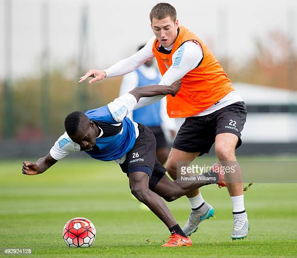 Idrissa Gana of Aston Villa in action with team mate Gary Gardner during a Aston Villa training session at the club's training ground at Bodymoor...