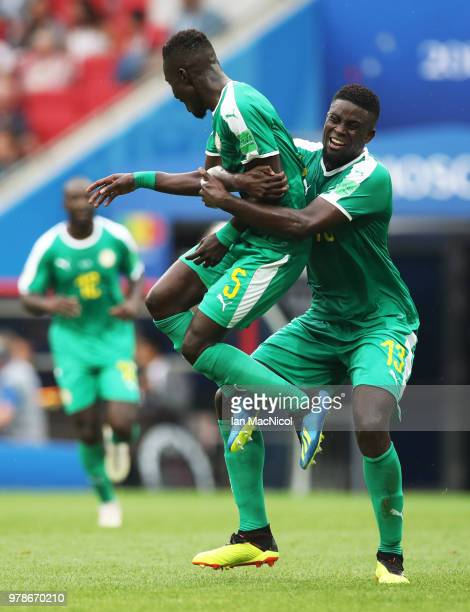 Idrissa Gueye and Alfred N'Diaye of Senegal celebrates their sides first goal during the 2018 FIFA World Cup Russia group H match between Poland and...