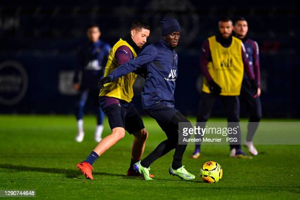 Idrissa Gueye and Ander Herrera fight for the ball during a Paris Saint-Germain training session at Ooredoo Center on December 11, 2020 in Paris,...