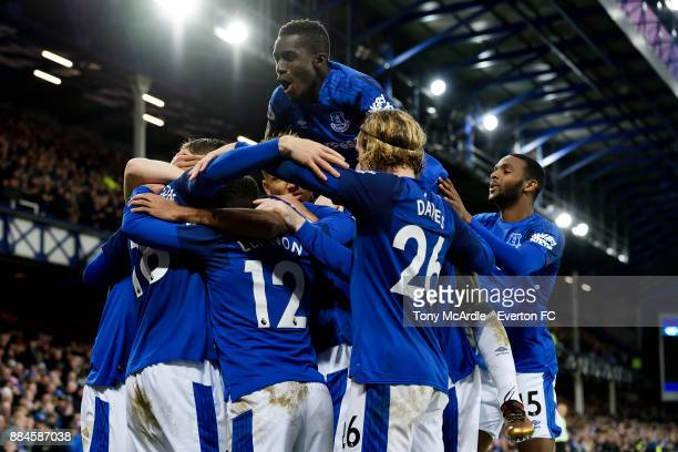 Idrissa Gueye and Cuco Martina of Everton celebrate the goal of Gylfi Sigurdsson during the Premier League match between Everton and Huddersfield...
