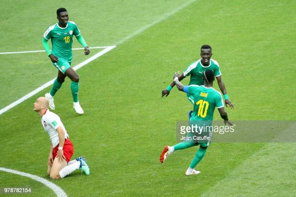 Idrissa Gueye between Ismaila Sarr and Sadio Mane of Senegal celebrate the first goal of Senegal during the 2018 FIFA World Cup Russia group H match...