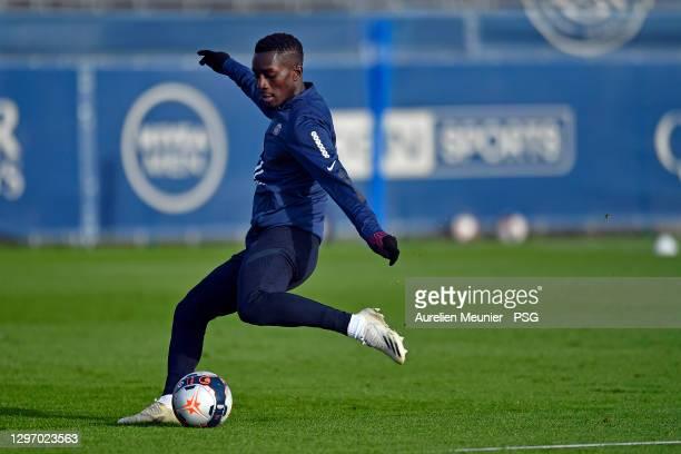 Idrissa Gueye kicks the ball during a Paris Saint-Germain training session at Ooredoo Center on January 18, 2021 in Paris, France.