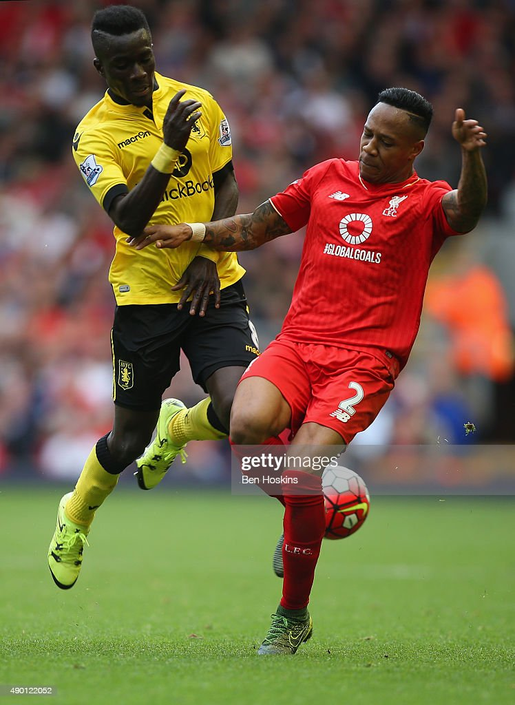 Idrissa Gueye of Aston Villa and Nathaniel Clyne of Liverpool compete for the ball during the Barclays Premier League match between Liverpool and Aston Villa at Anfield on September 26, 2015 in Liverpool, United Kingdom.