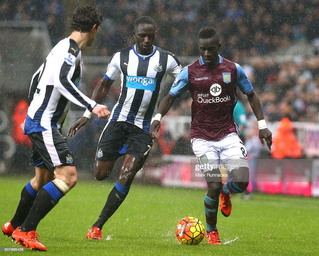 Idrissa Gueye of Aston Villa takes on Moussa Sissoko and Daryl JanMaat of Newcastle during the Barclays Premier League match between Newcastle United FC and Aston Villa FC at St James' Park on December 19, 2015 in Newcastle Upon Tyne, England.