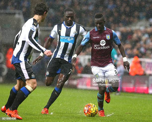 Idrissa Gueye of Aston Villa takes on Moussa Sissoko and Daryl JanMaat of Newcastle during the Barclays Premier League match between Newcastle United...