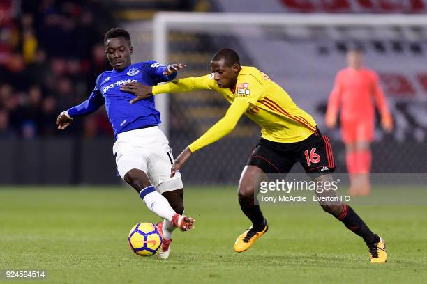 Idrissa Gueye of Everton and Abdoulaye Doucoure of Watford challenge for the ball during the Premier League match between Watford and Everton at...