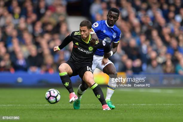 Idrissa Gueye of Everton and Eden Hazard of Chelsea challenge for the ball during the Premier League match between Everton and Chelsea at the...