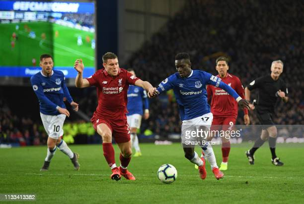 Idrissa Gueye of Everton and James Milner of Liverpool battle for the ball during the Premier League match between Everton FC and Liverpool FC at...