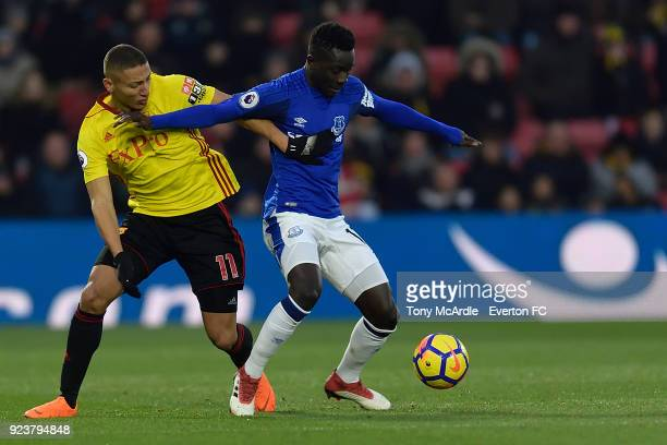 Idrissa Gueye of Everton and Richarlison of Watford challenge for the ball during the Premier League match between Watford and Everton at Vicarage...