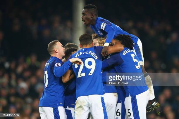 Idrissa Gueye of Everton and team mates congratulate Gylfi Sigurdsson of Everton as he scores their second goal during the Premier League match...
