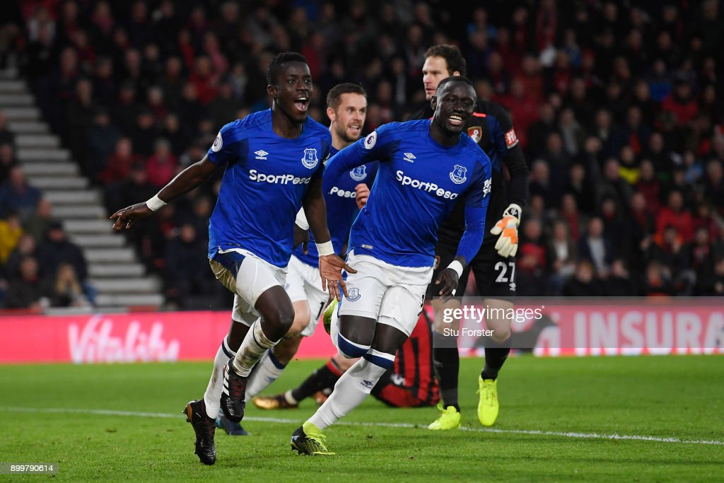Idrissa Gueye (L) of Everton celebrates scoring his team's opening goal with Oumar Niasse of Everton during the Premier League match between AFC Bournemouth and Everton at Vitality Stadium on December 30, 2017 in Bournemouth, England.