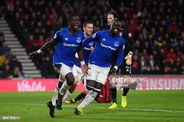 Idrissa Gueye of Everton celebrates scoring his team's opening goal with Oumar Niasse of Everton during the Premier League match between AFC...