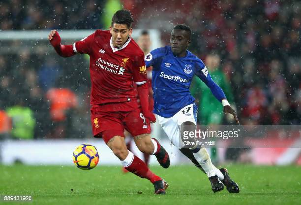 Idrissa Gueye of Everton chases down Roberto Firmino of Liverpool during the Premier League match between Liverpool and Everton at Anfield on...