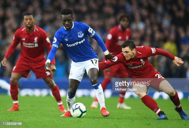 Idrissa Gueye of Everton holds off Andy Robertson of Liverpool during the Premier League match between Everton FC and Liverpool FC at Goodison Park...