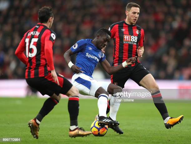 Idrissa Gueye of Everton is challenged by Adam Smith of AFC Bournemouth and Dan Gosling of AFC Bournemouth during the Premier League match between...
